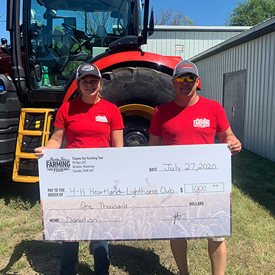 Thunderstruck donating cheque to Craik 4H club